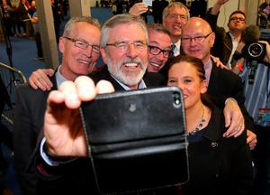 Sinn Fein leader Gerry Adams takes a 'selfie' with Mary Lou McDonald and the party's Belfast candidates as counting in the general election gets underway at the kings Hall in Belfast. PRESS ASSOCIATION Photo. Picture date: Thursday May 7, 2015. See PA story ELECTION Main. Photo credit should read: Niall Carson/PA Wire
