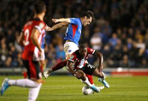 Soccer Football - Carabao Cup - Third Round - Portsmouth v Southampton - Fratton Park, Portsmouth, Britain - September 24, 2019  Portsmouth's John Marquis in action with Southampton's Michael Obafemi       Action Images via Reuters/John Sibley