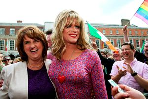 'Panti Bliss' aka Rory O'Neill with Tanaiste Joan Burton at the Central Count Centre in Dublin Castle, Dublin, after Zappone proposed live on TV as votes are continued to be counted in the referendum on same-sex marriage.   Brian Lawless/PA Wire