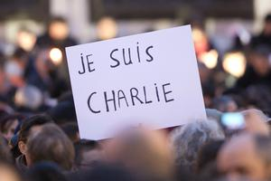 Signs saying 'Je suis Charlie' are held up as crowds gather at 'Place de la Republique' for a vigil following the terrorist attack earlier today on January 7, 2015 in Paris, France. Twelve people were killed, including two police officers, as two gunmen opened fire at the offices of the French satirical publication Charlie Hebdo (Photo by Marc Piasecki/Getty Images)