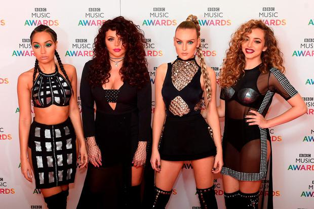 (from left) Leigh-Anne Pinnock, Jesy Nelson, Perrie Edwards and Jade Thirlwall of Little Mix arrive on the red carpet for the BBC Music Awards at the Genting Arena, Birmingham. PRESS ASSOCIATION Photo. Picture date: Thursday December 10, 2015. Photo credit should read: Joe Giddens/PA Wire