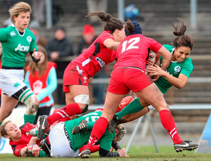 Jackie Shiels, Ireland, is tackled by Gemma Rowland and Sian Williams, Wales
