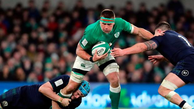 Ireland's CJ Stander (centre) is tackled by Scotland's Rory Sutherland and Scott Cummings. Photo: Niall Carson/PA Wire