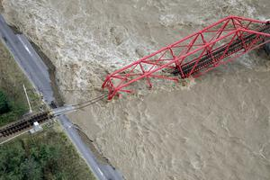 A collapsed railway bridge is seen over Chikuma river swollen by Typhoon Hagibis in Ueda, central Japan, October 13, 2019, in this photo taken by Kyodo. Mandatory credit Kyodo/via REUTERS