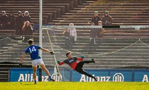 Mayo goalkeeper David Clarke watches on as Kerry's David Clifford crashes an early penalty off the crossbar in Castlebar. Photo: Brendan Moran/Sportsfile