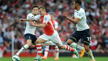 Arsenal's Jack Wilshere is tackled by Tottenham Hotspur's Ryan Mason and Etienne Capoue