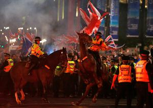 A police horse rears up as pro-union protestors clash with pro-independence protestors during a demonstration at George Square in Glasgow, Scotland September 19, 2014.
