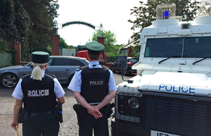 Police and army bomb disposal experts at Shandon Park Golf Club in east Belfast on Saturday June 1. Photo: PA