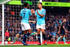Manchester City's Gabriel Jesus (right) celebrates scoring his side's fourth goal of the game with Raheem Sterling during the Emirates FA Cup, third round match at the Eithad Stadium, Manchester. Sunday January 6, 2019. Martin Rickett/PA Wire.