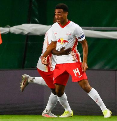 Leipzig's Tyler Adams celebrates after his shot found the Atletico net. Photo: AP