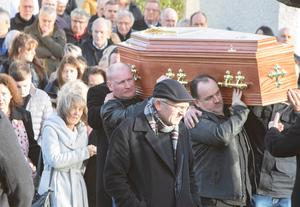The remains of young mum Jasmine McMonagle is carried from St Mary's Church Castlefin to her last resting place in the nearby cemetery.  (North West Newspix)