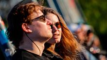 People sit and watch the sun set in Berlin, amid the novel coronavirus COVID-19 pandemic. (Photo by DAVID GANNON/AFP via Getty Images)