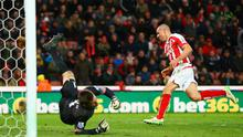 Jonathan Walters turns to celebrate after completing his hatrick against Queens Park Rangers at the Britannia Stadium.