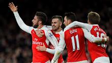 Olivier Giroud celebrates scoring the second goal for Arsenal with Aaron Ramsey, Mesut Ozil and Nacho Monreal