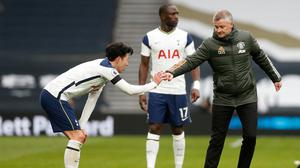 Manchester United manager Ole Gunnar Solskjaer bumps fists with Tottenham Hotspur's Son Heung-min after the Premier League clash at Tottenham Hotspur Stadium, London
