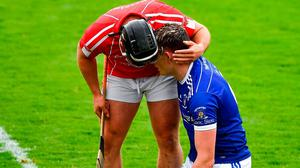 Fallen comrade: Noel Connors of Passage has a word of consolation to his former Waterford team-mate Austin Gleeson of Mount Sion following yesterday's county semi-final. Photo: Sportsfile