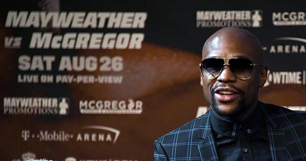Boxer Floyd Mayweather Jr. arrives at a news conference at the KA Theatre at MGM Grand Hotel & Casino on August 23, 2017 in Las Vegas, Nevada. Mayweather will meet UFC lightweight champion Conor McGregor in a super welterweight boxing match at T-Mobile Arena on August 26 in Las Vegas. (Photo by Ethan Miller/Getty Images)