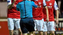 10 April 2015; St Patrick's Athletic players Killian Brennan, left, and Ger O'Brien remonstrate with referee Derek Tomney after their team-mate Lee Desmond was shown a red card. SSE Airtricity League, Premier Division, St Patrick's Athletic v Cork City. Richmond Park, Dublin. Picture credit: David Maher / SPORTSFILE