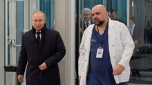 Russian President Vladimir Putin listens to Denis Protsenko, chief physician of a hospital for patients infected with coronavirus disease on the outskirts of Moscow. Photo: Reuters