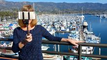 A woman use a selfie stick to take a self-portrait in Santa Barbara, California. Photo: Moment Editorial/Getty Images