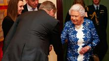 Queen Elizabeth II greets Sir Jeremy Heywood (back to camera) as she attends a reception for female permanent secretaries at The Queen's Gallery on February 21, 2017 in London, England. (Photo by Jonathan Brady - WPA Pool / Getty Images)