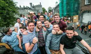 7/9/2015: Kilkenny hurlers including Michael and Colin Fennelly, Cillian Buckley and Jackie Tyrrell celebrate on the bus as it leaves Kilkenny Castle Park on the way to Nowlan Park during the homecoming for the Kilkenny team. Photo: Pat Moore.