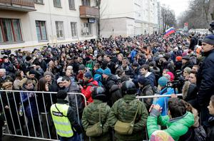 Protesters shout slogans outside a courthouse in Moscow February 24, 2014. Seven opponents of President Vladimir Putin were sentenced to prison terms ranging from two and a half to four years on Monday over a demonstration that turned violent, and riot police detained over 100 people protesting outside the court