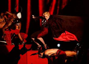 Madonna stumbles whilst performing on stage as her cape is pulled during the 2015 Brit Awards at the O2 Arena, London
