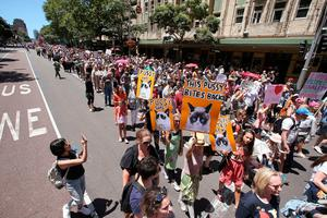 "Thousands file through the streets during the Women's March in Sydney, Australia, Saturday, Jan. 21, 2017. Protesters at the Women's March rally carried placards with slogans including ""Women of the world resist,"" ''Feminism is my trump card"" and ""Fight like a girl."" (AP Photo/Rick Rycroft)"