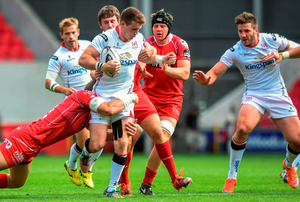 Stuart McCloskey, Ulster, is tackled by Michael Tagicakibau, Scarlets