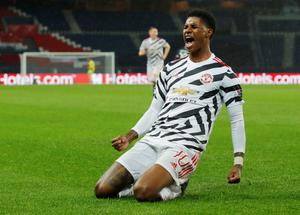 Manchester United's Marcus Rashford celebrates scoring the winning goal in the 2-1 win over PSG. REUTERS/Gonzalo Fuentes