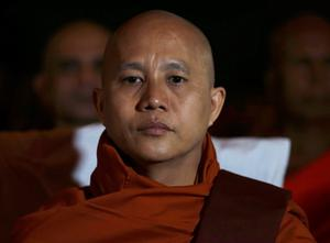 Buddhist monk Ashin Wirathu, leader of the 969 movement, looks on as he attends a convention held by the Bodu Bala Sena (Buddhist Power Force, BBS) in Colombo. Wirathu, a radical monk who heads a movement accused of stirring violence against Muslims in Myanmar has announced a partnership with BBS, a hardline Buddhist group in Sri Lanka to defend their religion. Reuters/Dinuka Liyanawatte