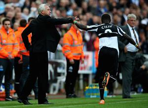 Alan Pardew, manager of Newcastle United congratulates Papiss Cisse on his goal
