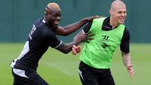 Mario Balotelli and Martin Skrtel of Liverpool in action during a training session