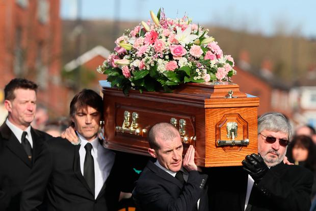 The coffin of Carlingford drowning victim Ruth Maguire is carried by her partner James Griffin (left) and father Malachy, as it makes it way to Saint Vincent de Paul church, Ligoniel, Belfast ahead of her funeral.