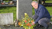 Michael Moynihan TD, laying a wreath on the grave of Paddy McCarthy in Clonfert Graveyard, Newmarket, on behalf of the families of 'The Men of the South'. Photo: Sheila Fitzgerald