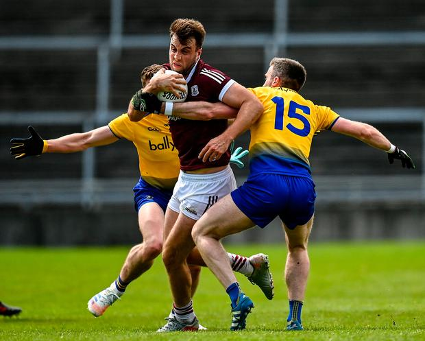 Galway's Paul Conroy in action against Roscommon's Cathal Cregg, right, and Eddie Nolan during the Allianz Football League Division 1 South match at Pearse Stadium in Galway. Photo: Harry Murphy/Sportsfile