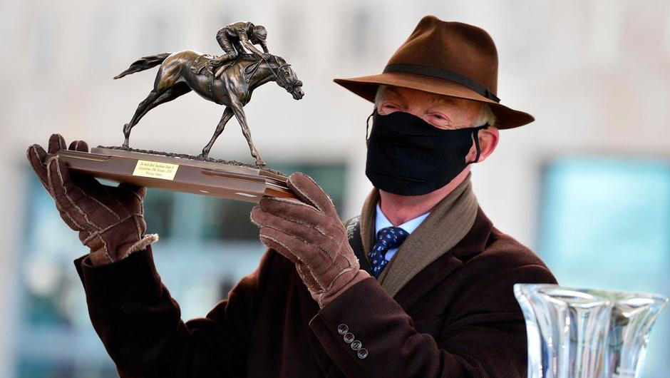 Willie Mullins, picking up the trophy for Grade One Novice Chase winner Monkfish, enjoyed a 55/1 four-timer at yesterday's concluding day of the Leopardstown Christmas Festival. Photo: PA