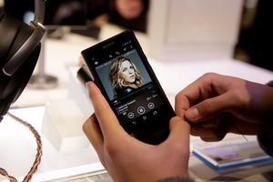 An attendee holds Sony's new Walkman at the Sony booth at the International CES in Las Vegas. (AP Photo/Jae C. Hong)