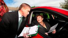 Cormac Devlin talks to local Norah Higgins while canvassing in Glenageary Park. Photo: Steve Humphreys