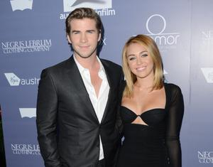 (FILE PHOTO) According to reports from The New York Post's Page Six Miley Cyrus and Liam Hemsworth have called time on their relationship. CENTURY CITY, CA - JUNE 27:  (L-R) Actors Liam Hemsworth and Miley Cyrus arrive at Australians In Film Awards & Benefit Dinner at InterContinental Hotel on June 27, 2012 in Century City, California.  (Photo by Jason Merritt/Getty Images for AIF)