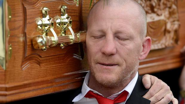 Heartbroken former WBU champion Eamonn Magee carries the coffin of his son Eamonn Jnr at his funeral in Belfast