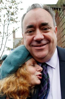 Scottish First Minister Alex Salmond with a Yes supporter in Turriff during a historic day for Scotland as voters determine whether the country should remain part of the United Kingdom.