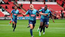 Wycombe Wanderers Alex Samuel celebrates scoring his side's fourth goal of the game during the Sky Bet League One play-off semi final first leg. Photo credit: Martin Rickett/PA Wire.