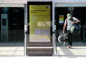 Welcome back: A notice for arriving passengers regarding the Covid-19 passenger locator form at Terminal 2 at Dublin Airport. Picture: PA
