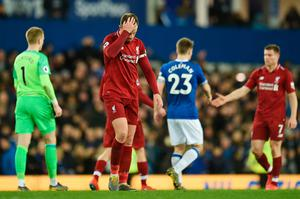 FRUSTRATION: Liverpool skipper Jordan Henderson reacts after last Sunday's draw with Everton at Goodison Park. Photo: AFP/Getty Images