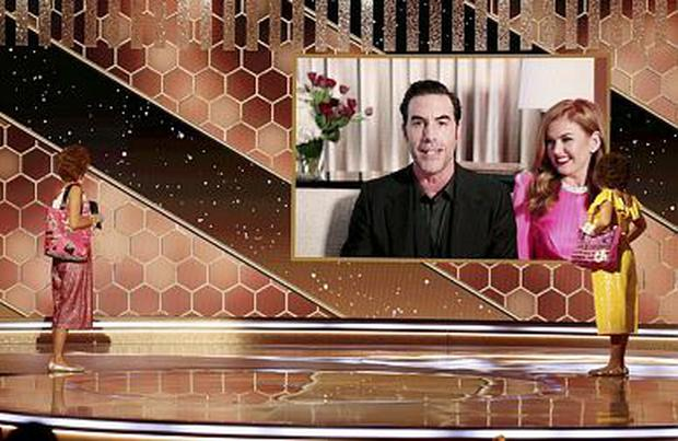 "Sacha Baron Cohen, with Isla Fisher, accepts the Best Picture - Musical/Comedy award for ""Borat Subsequent Moviefilm""   NBC Handout via REUTERS"