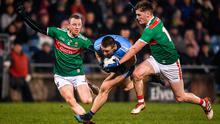 John Small of Dublin is tackled by Colm Boyle, left, and James Carr of Mayo