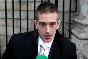 Michael Kivlehan, whose wife Dhara Kivlehan died from multi-organ failure in Belfast's Royal Victoria Hospital in September 2010, speaking to the media outside the Four Courts in Dublin