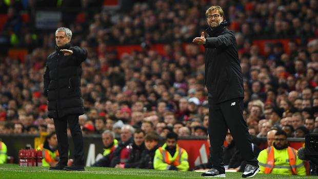MANCHESTER, ENGLAND - JANUARY 15:  Jurgen Klopp manager of Liverpool and Jose Mourinho manager of Manchester United give instructions during the Premier League match between Manchester United and Liverpool at Old Trafford on January 15, 2017 in Manchester, England.  (Photo by Mike Hewitt/Getty Images)